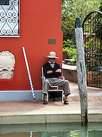 Gondolier waiting for a fair at Torcello Island Neer Venice Italy.