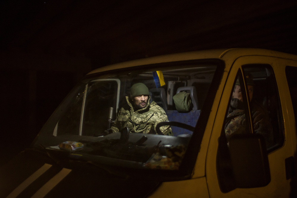 PERVOMAISKE, UKRAINE - MARCH 19, 2015: Volodya, who uses the name Svist and is a member of the pro-Ukrainian Dnipro-1 battalion, sits in a van at one of the group's bases known as The Bridge near ongoing battles for the town of Pisky in Pervomaiske, Ukraine. CREDIT: Brendan Hoffman for The New York Times
