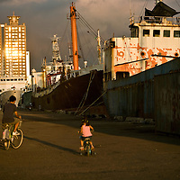 Biking along the harbor between Love Pier and Pier 2..