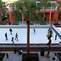 CELEBRATION, FL -- December 2, 2010 -- Children skate on fake ice in the downtown area of in the small, Disney master-planned community just a block away from the crime scene of the town's first murder in Celebration, Fla., on December 2, 2010.  The town's first murder in its 14 year existence has drawn buzz worldwide and amongst its citizens alike.