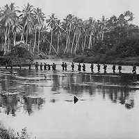 1943 - Marine patrol making their way through water on Guadalcanal.