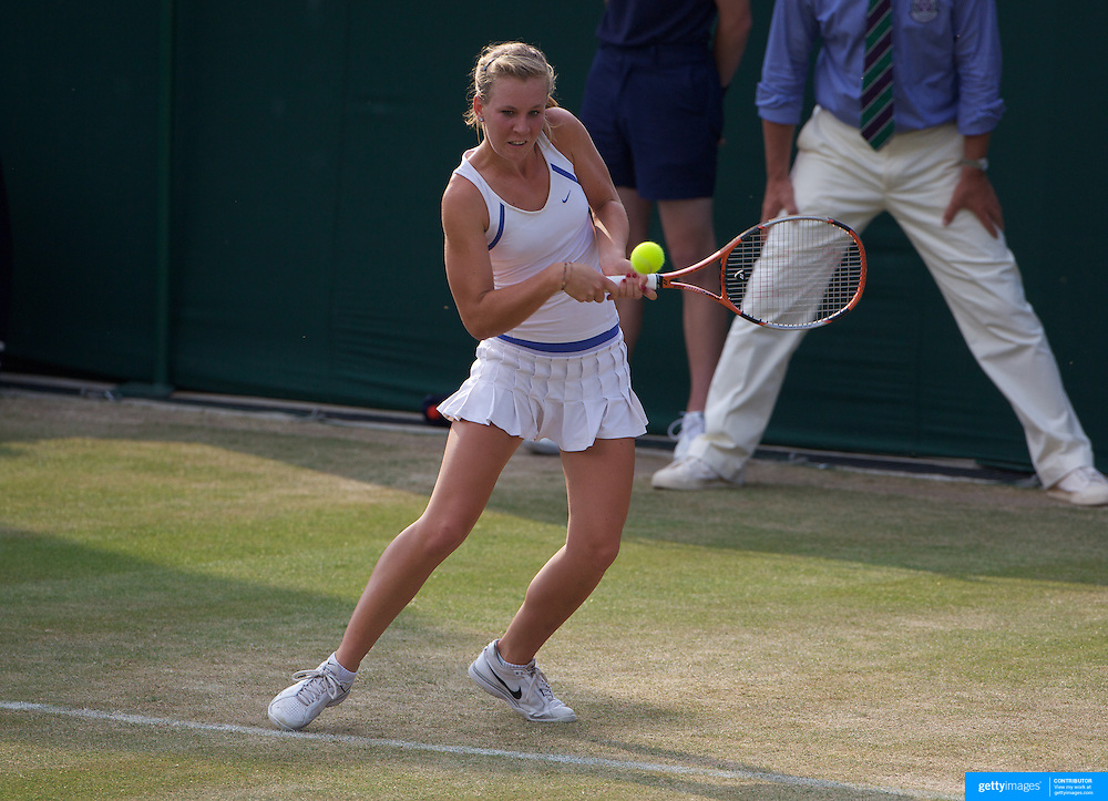 Olivia Rogowska, Australia, in action against Lesley Kerkhove, The Netherlands, duing the Girls Singles competition at the All England Lawn Tennis Championships at Wimbledon, London, England on Monday, June 29, 2009. Photo Tim Clayton.