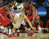 Ole Miss' Jarvis Summers (32), Wisconsin's Ben Brust (1), and Ole Miss' LaDarius White (10) go for the ball in the NCAA Tournament at the Sprint Center in Kansas City, Mo. on Friday, March 22, 2013.
