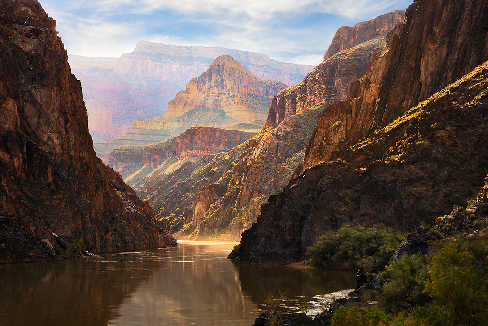 Early morning light illuminates a layer of moist air above the Colorado River.