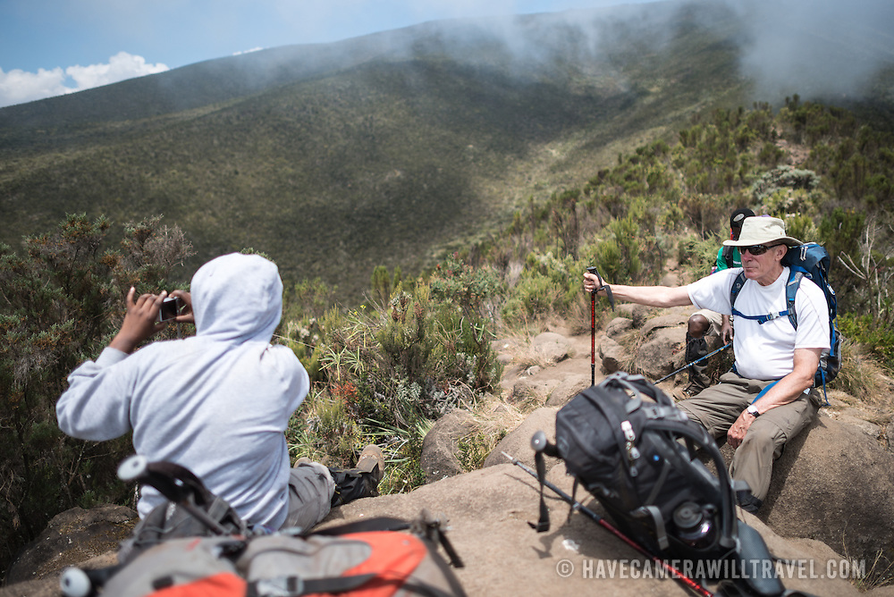 Hikers take a break in the heath zone on Mt Kilimanjaro's Lemosho Trail at about 10,000 feet.