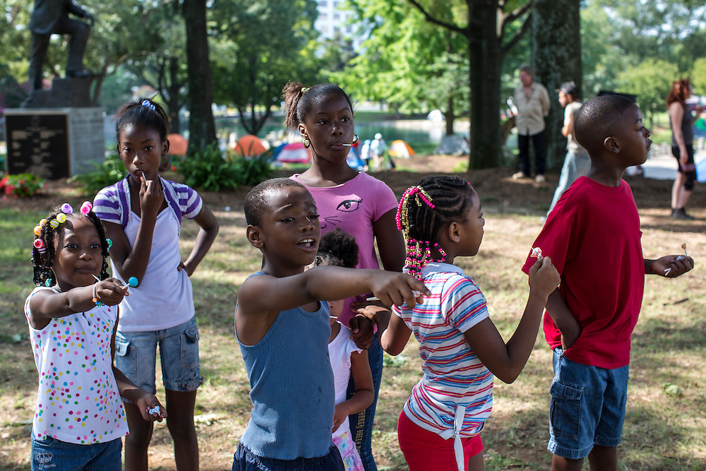 Children watch a Labor Day parade and march near the security perimeter for the Democratic National Convention on Monday, September 3, 2012 in Charlotte, NC.