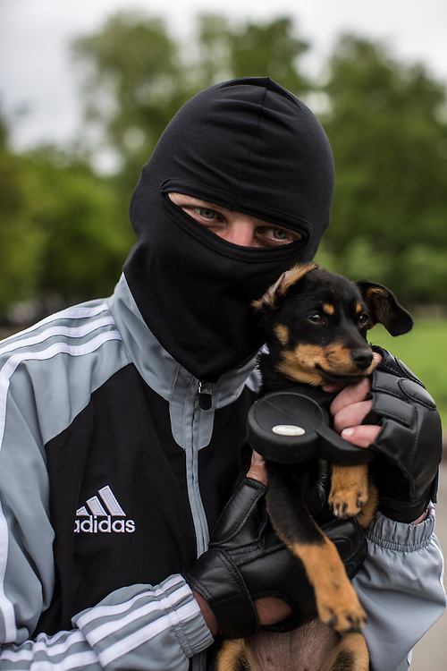 DONETSK, UKRAINE - MAY 8: A pro-Russian activist poses for a picture with a puppy on May 8, 2014 in Donetsk, Ukraine. Tensions in Eastern Ukraine are high after pro-Russian activists seized control of at least ten cities and ahead of the Victory Day holiday and a planned referendum on greater autonomy for the region. (Photo by Brendan Hoffman/Getty Images) *** Local Caption ***