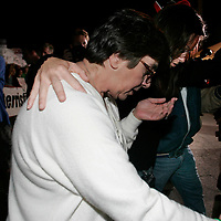 Mary Schindler (L) is comforted by daughter Suzanne Vitadamo(R) as two walk way from the Woodside Hospice on after visiting  Schindler's other daughter Terri Schiavo on March 23, 2005 in Pinellas Park, Florida. REUTERS/Scott Audette