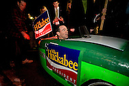 Republican presidential hopeful and former Arkansas governor Mike Huckabee takes a test ride in a pedal-powered car at a polling station in Manchester, N.H., on Tuesday, Jan. 8, 2008.