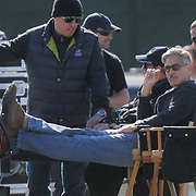 HOLLYWOOD ACTOR AND DIRECTOR GEORGE CLOONEY PUTTING HIS FEET UP AFTER A HARD DAYS FILMING AT DUXFORD MUSEUM,CAMBRIDGESHIRE, ON MONDAY EVENING JUNE 3RD..<br /> <br />  George Clooney was seen putting his feet up after a hard day directing Hollywood A-listers on the set of his new movie Monuments Men.<br /> <br /> The silver-haired actor took some time out yesterday evening (Mon) after a busy day shooting scenes on location in Cambridgeshire with his old friend Matt Damon and veteran stars Bill Murray and John Goodman.<br /> <br /> The 52-year-old, who is also acting in the Second World War drama, has had several long days directing the cast at The Imperial War Museum in Duxford and clearly needed a rest.<br /> <br /> Clooney, who was dressed down in a hoody, jeans and shades looked like one of the crowd as he relaxed in his director's chair as the day's filming came to an end.<br /> <br /> He was joined on the set yesterday by actor Bill Murray, 62, who was seen chatting to Clooney wearing a green army uniform with khaki braces and a green neck tie.<br /> <br /> Murray, who is famous for his roles in Ghostbusters and Groundhog Day, then had a quick costume change into a smart double-breasted suit.
