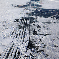 """.Project called """"Holes"""" which features photos of ice fishing holes."""