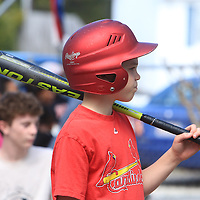 Conner Leach, 12 waits to bat at The Stadium batting cages on Oleander drive Sunday March 9, 2014. (Jason A. Frizzelle)