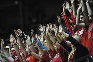 "Students hold their hands up during a free throw at Ole Miss vs. Missouri at the C.M. ""Tad"" Smith Coliseum in Oxford, Miss. on Saturday, February 8, 2014. (AP Photo/Oxford Eagle, Bruce Newman)"