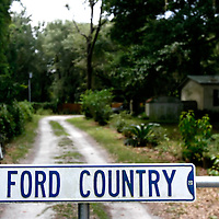 "ARCHER, FL -- August 23, 2009 -- A ""Ford Country"" sign hangs on the gate to the home of Larry Ford in Archer, Fla., on Sunday, August 23, 2009.  The self-described cowboy lives on seven acres in rural Florida with a horse, 4 dogs, and a handful of cats on his property after his wife died three years ago.  He took out a reverse mortgage on his home, but in July, the owner of the Orlando, Fla., title company that handled Mr. Fordâ??s loan admitted to stealing more than $1 million from several reverse mortgages, including Mr. Fordâ??s. Bank of America Corp., which says the title agent never sent it the money required to pay off Mr. Fordâ??s mortgage, is now threatening to foreclose on his ranch..(CREDIT:  Chip Litherland for the Wall Street Journal)..REVERSE"