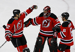 Jan 4, 2008; Newark, NJ, USA; New Jersey Devils center Brian Rolston (12) celebrates his game-winning goal with New Jersey Devils goalie Scott Clemmensen (35) and New Jersey Devils defenseman Andy Greene (6) during overtime at the Prudential Center. The Devils defeated the Senators 4-3 in overtime.