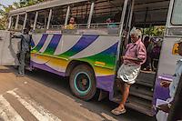 Indian gentleman disembarking a bus