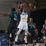 Delaware 87ers Guard NATE ROBINSON (1) attempts a jump shot as Greensboro Swarm Guard Mardracus Wade (5) defends in the first half of an NBA D-league regular season game between the Delaware 87ers and the Greensboro Swarm (Charlotte Hornets) Wednesday, March 29, 2017, at The Bob Carpenter Sports Convocation Center in Newark, DEL