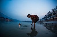 Kid making offering to the Ganga, Rishikesh - India