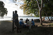 Mauritius. Fisherman play a game of cards at Tamarin beach.