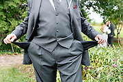 The father of the bride, shows his empty pockets, following his daughters wedding in central Illinois over Labor Day weekend. The average cost of a wedding is reported to be about $30,000.