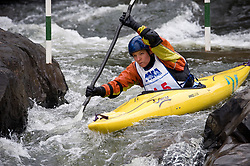 Piper Wall of Ames, Iowa races in the K1 women's expert class during the slalom course of the 42nd Annual Missouri Whitewater Championships. Wall placed first place in the class. The Missouri Whitewater Championships, held on the St. Francis River at the Millstream Gardens Conservation Area, is the oldest regional slalom race in the United States.
