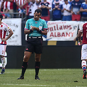 Referee ARBITER BASCUNAN writes a note in the first half of a Copa America Centenario Group A match between the United States and Paraguay Saturday, June. 11, 2016 at Lincoln Financial Field in Philadelphia, PA.