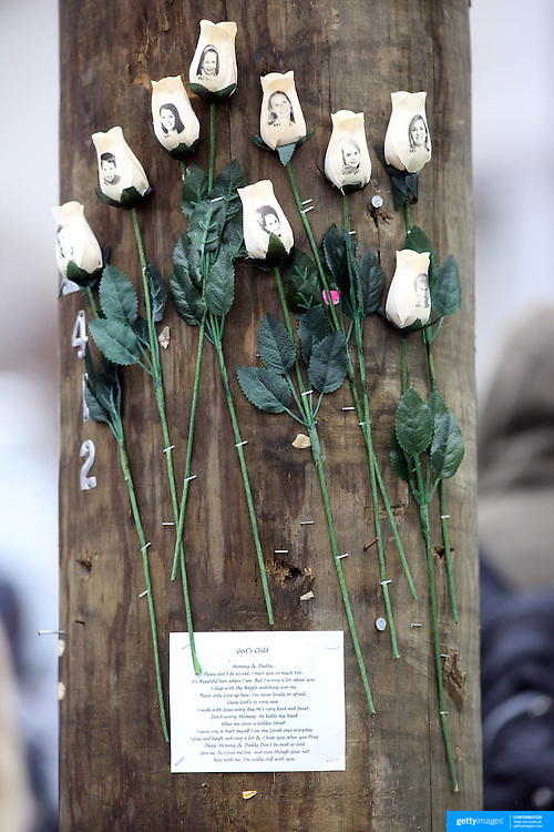 White roses with images of the victims of the tragedy in Sandy Hook on a telegraph pole in the town centre after the mass shootings at Sandy Hook Elementary School, Newtown, Connecticut, USA. 17th December 2012. Photo Tim Clayton