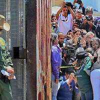 SAN YSIDRO, CA-APRIL 30:  Janet Vargas,Middle back facing, hugs her Mother and Father after Customs and Border Patrol agents opened the fence during a Children's Day celebration for families to embrace on Saturday, April 30, 2016 at Friendship Park in San Ysidro, CA.(Photo by Sandy Huffaker for The Washington Post)