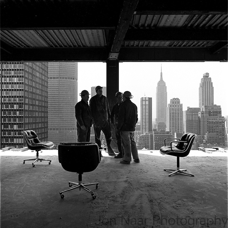 NY downtown skyline from 30th floor of unfinished building with construction workers standing by Pollock chairs in 1968.  Taken with 35mm Nikon FM.
