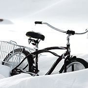 """SHOT 1/10/09 5:32:39 PM - A cruiser bike stuck in a snowbank in a backyard in Crested Butte, Co. Bikes are a popular form of transportation in the small mountain town even in the wintertime. Crested Butte is a Home Rule Municipality in Gunnison County, Colorado, United States. A former coal mining town now called """"the last great Colorado ski town"""", Crested Butte is a destination for skiing, mountain biking, and a variety of other outdoor activities. The population was 1,529 at the 2000 census. The Colorado General Assembly has designated Crested Butte the wildflower capital of Colorado. The primary winter activity in Crested Butte is skiing or snowboarding at nearby Crested Butte Mountain Resort in Mount Crested Butte, Colorado. Backcountry skiing in the surrounding mountains is some of the best in Colorado. The mountain, Crested Butte, rises to 12,162 feet (3,700 m) above sea level..(Photo by Marc Piscotty / © 2009)"""