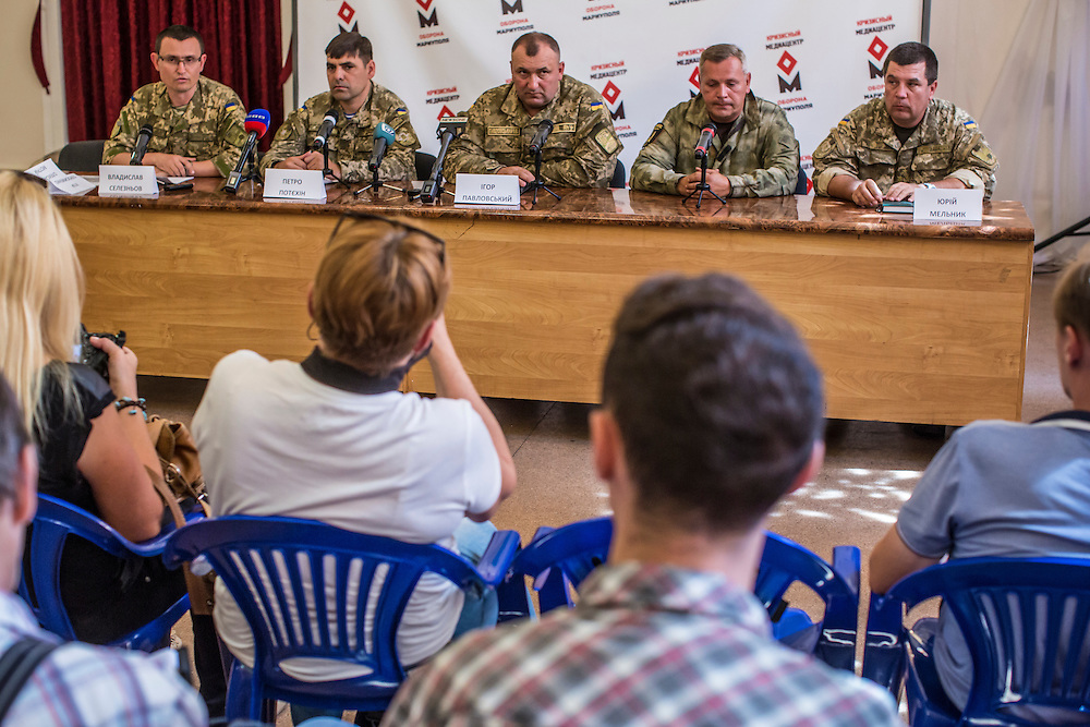 MARIUPOL, UKRAINE - AUGUST 28, 2015: Ukrainian army officials discuss the one year anniversary of the battle of Ilovaisk at a news conference in Mariupol, Ukraine. The notorious and controversial incident took place when Ukrainian forces were surrounded by pro-Russian rebel fighters and then ambushed after supposedly negotiating a corridor to retreat safely. Hundreds reportedly died or were taken prisoner. CREDIT: Brendan Hoffman for The New York Times