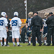 Team captains meet midfield before game between Duke and Notre Dame. The  third-ranked Fighting Irish defeated sixth-ranked Duke, 13-5, in men's lacrosse action on a snowy Saturday afternoon at Koskinen Stadium in Durham, N.C.