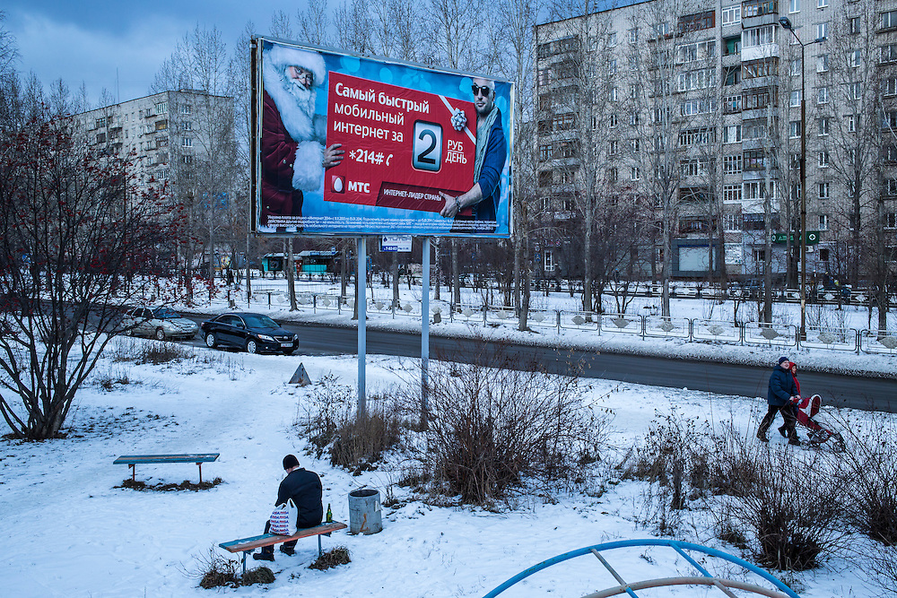 A man sits on a bench to smoke a cigarette on Saturday, November 30, 2013 in Asbest, Russia.