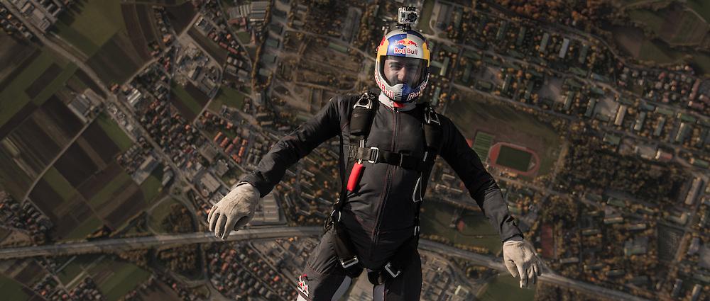 Red Bull Skydive Team member Marco Waltenspiel is backflying over Salzburg