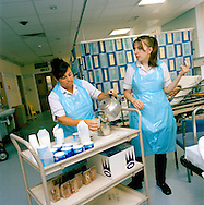 Catering staff serving food to patients in the newly opened Accident and Emergency Department at the Royal Albert Edward Infirmary in Wigan, Lancashire, UK. The hospital is part of the Wrightington, Wigan and Leigh NHS Trust..Photo by Steve Forrest