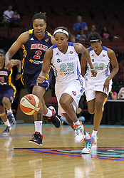 June 3, 2012; Newark, NJ, USA; New York Liberty guard Cappie Pondexter (23) steals the ball from Indiana Fever forward Eriana Larkins (2) during the first half at the Prudential Center.