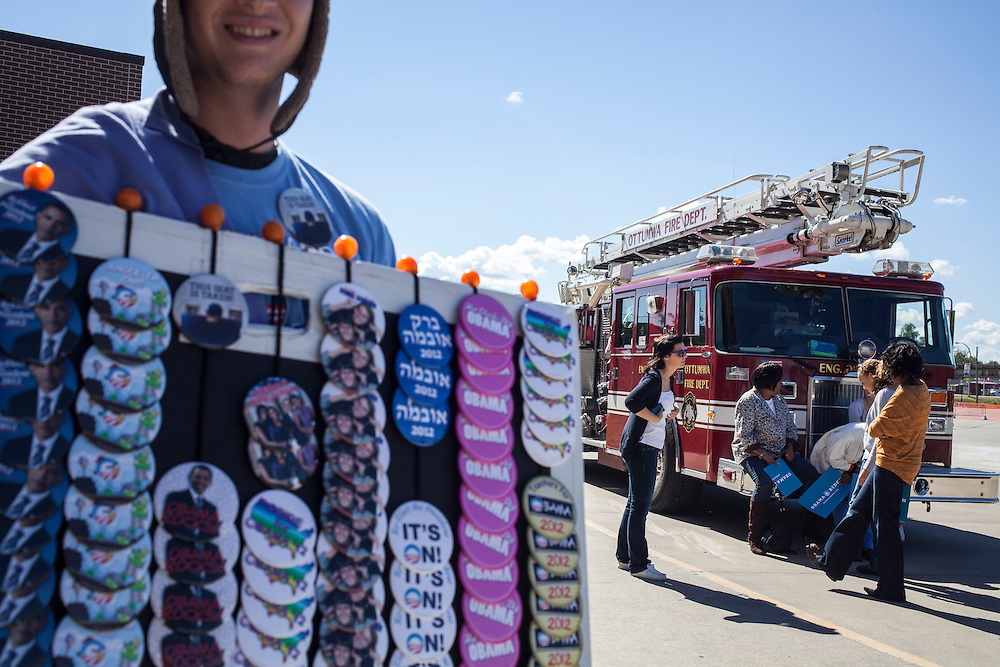 A man sells buttons outside a campaign rally with Vice President Joe Biden on Tuesday, September 18, 2012 in Ottumwa, IA.