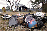 01/07/06-(Rockingham County) .Salvaged family photographs lie on the front lawn of a home on 8905 East Side Highway in Elkton following a fire Saturday morning..Photo by: Pete Marovich/Daily News-Record