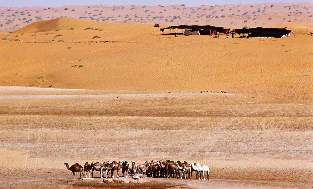 Wells (water holes) at Ash Shaqiq in the Nafud Desert, used by the Shammar tribe, camped nearby, during summer months.