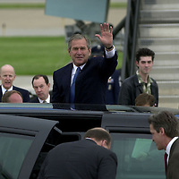 President George W. Bush waves to the crowd after stepping off Air Force One after arriving at  Minneapolis- St. Paul International Airport on Thursday, May 17, 2001.  In the foreground is St. Paul Mayor Norm Coleman and in the right background is Minnesota Governor Jesse Ventura and his son Jade.  (AP Photo/Adam M. Bettcher)