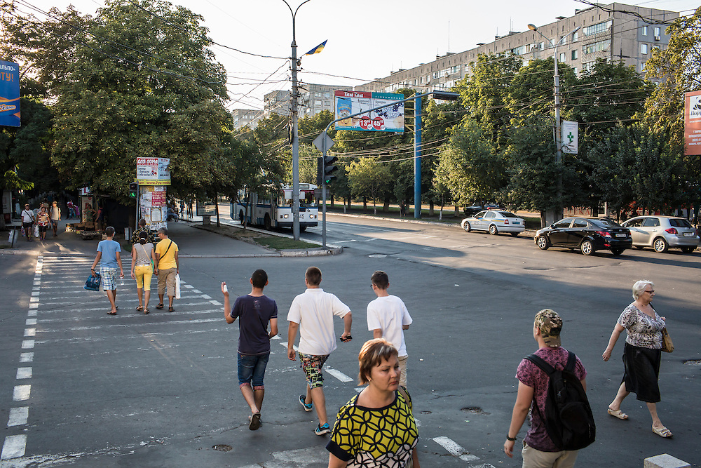 MARIUPOL, UKRAINE - AUGUST 29, 2015: Pedestrians walk in the center of Mariupol, Ukraine. Despite the front line being a relatively short distance away, Mariupol was lively on a warm summer weekend, with little evidence that people expect the fighting to advance this far. CREDIT: Brendan Hoffman for The New York Times