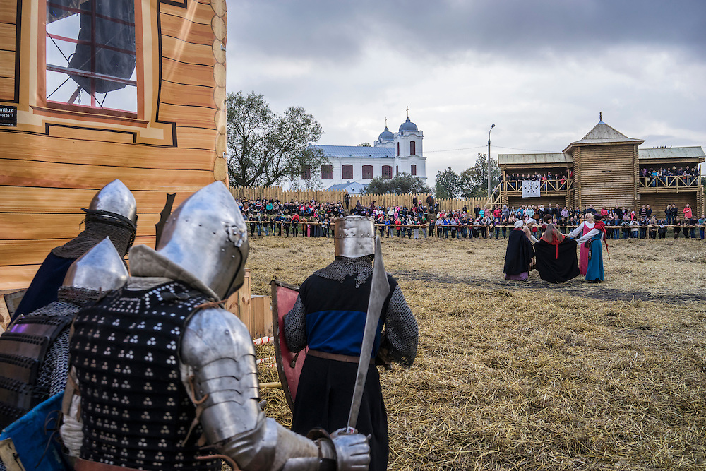 Men dressed in armor put on a fighting demonstration during a medieval festival on Saturday, September 24, 2016 in Mstislavl, Belarus.