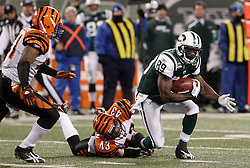 Jan 3, 2010; East Rutherford, NJ, USA; New York Jets wide receiver Jerricho Cotchery (89) is tackled after a catch by Cincinnati Bengals safety Tom Nelson (43) during the first half at Giants Stadium.