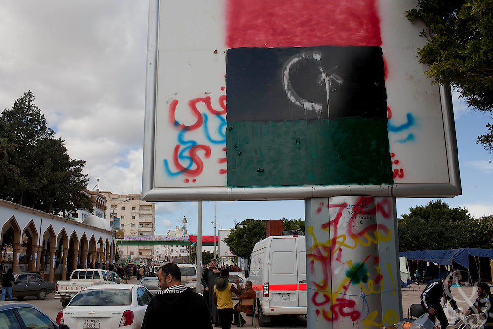 A new free Libyan flag is spray painted on a billboard near the town square February 23, 2011 in Darna, Libya. Libya tightened its grip on the capital, tripoli, but the rest of the country appeared to be slipping further out of his control. .Slug: Libya.Credit: Scott Nelson for the New York Times