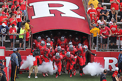 Sept 8, 2012; Piscataway, NJ, USA; The Rutgers Scarlet Knights take the field during the first half at High Point Solutions Stadium.