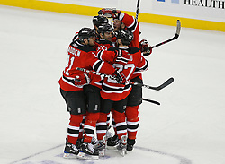 Apr 15, 2009; Newark, NJ, USA; The New Jersey Devils celebrate a goal by New Jersey Devils defenseman Mike Mottau (27) during the first period of game one of the eastern conference quarterfinals of the 2009 Stanley Cup playoffs at the Prudential Center.