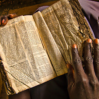 Bible held by a worshipper at a church in  Palotaka Sudan