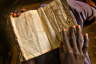 Bible held by a worshipper at a church in  Palotaka Sudan