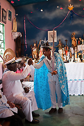 The Dominican missionaries catechesis, led the Rosary at Africa, imposing his cult to blacks. The addition of the elements of the coronation of kings, fights and dances are the African contribution.