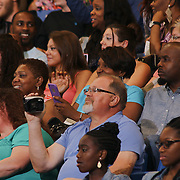 Family and Friends take photos at Christiana High School 52nd commencement exercises Monday, June 01, 2015, at The Bob Carpenter Sports Convocation Center in Newark, Delaware.